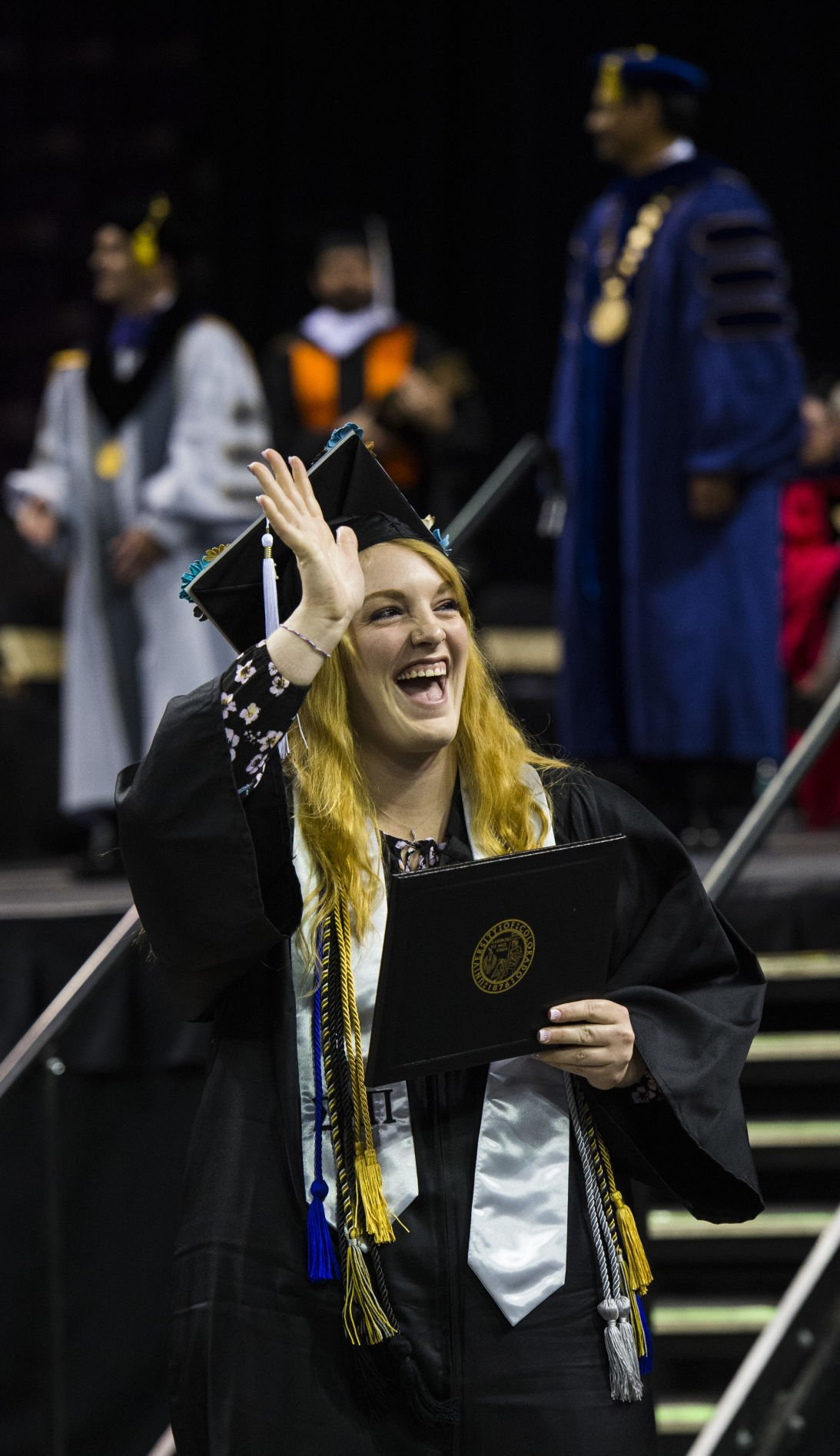 Katelyn Huddleston waves to her family after receiving her diploma during the University of Colorado at Colorado Springs' morning commencement ceremonies Friday, May 12, 2017, at the Broadmoor World Arena in Colorado Springs. A record 1,532 students received their degrees this Spring.  (The Gazette, Christian Murdock)