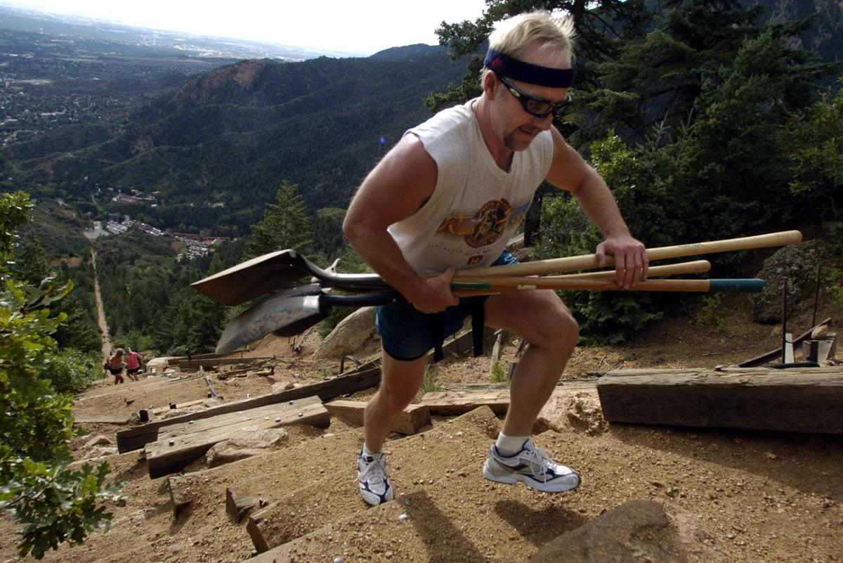 Robert Rodine of Divide carries a load of shovels up the Incline in Manitou Springs, Colo., Saturday, Sept. 10, 2005. The Incline was built in 1907 for the Mount Manitou Incline Railroad to aid the construction of a waterline. It was converted into a tourist attaction shortly afterward and closed in 1990. While it's not offically open to the public, it's a popular hiking spot among local athletes. Photo by Christian Murdock/The Gazette