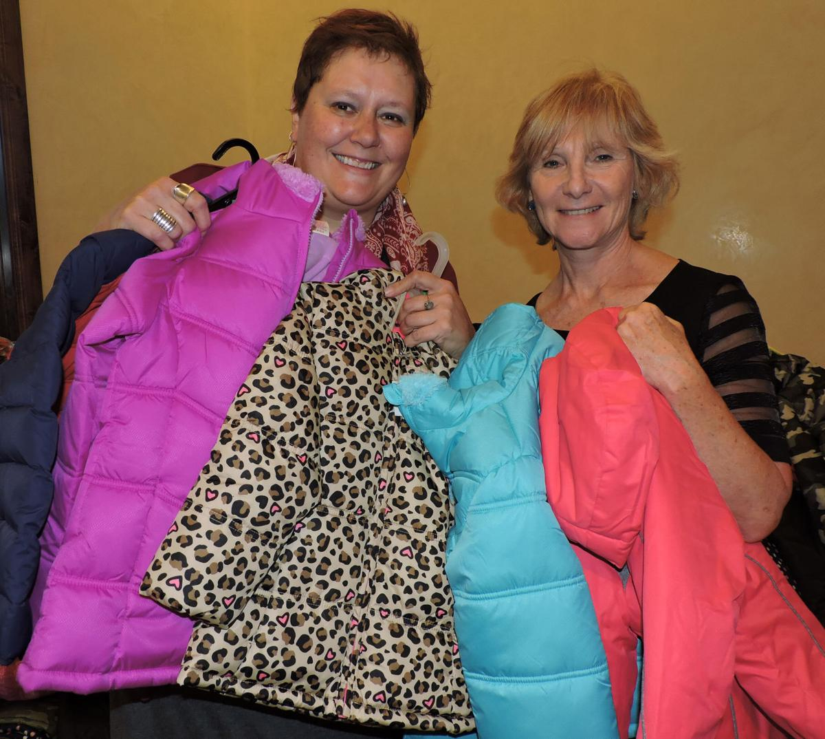 Abrams Elementary principal Lois Skaggs, left, with volunteer Madeleine Mellini, holds some of the hundreds of Koats 4 Kids donations destined for the Fountain-Fort Carson District 8 school. 102116 Photo by Linda Navarro102116 Photo by Linda Navarro