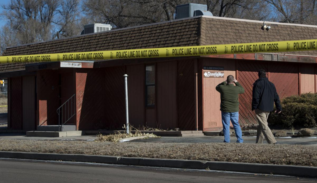 Colorado Springs police investigate the scene of an explosion Tuesday, Jan. 6, 2014, at Mr. G's Hair Salon at 603 S. El Paso Street in Colorado Springs. (The Gazette, Christian Murdock)