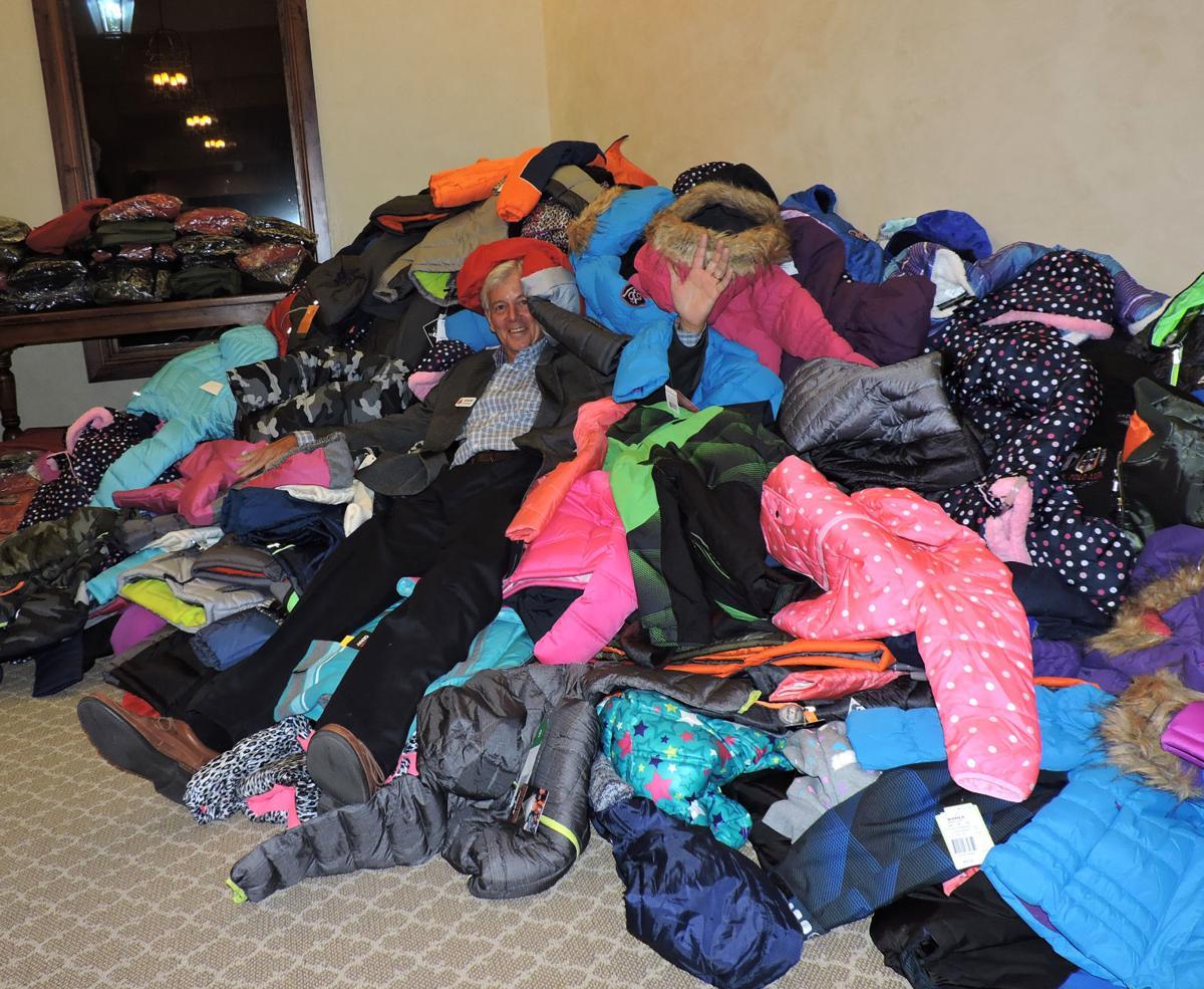Committee member Ed Doerffel did the coat-pile dive at Koats 4 Kids. 102116 Photo by Linda Navarro