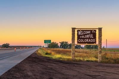 Welcome to colorful Colorado street sign along Interstate I-76 Photo Credit: miroslav_1 (iStock).