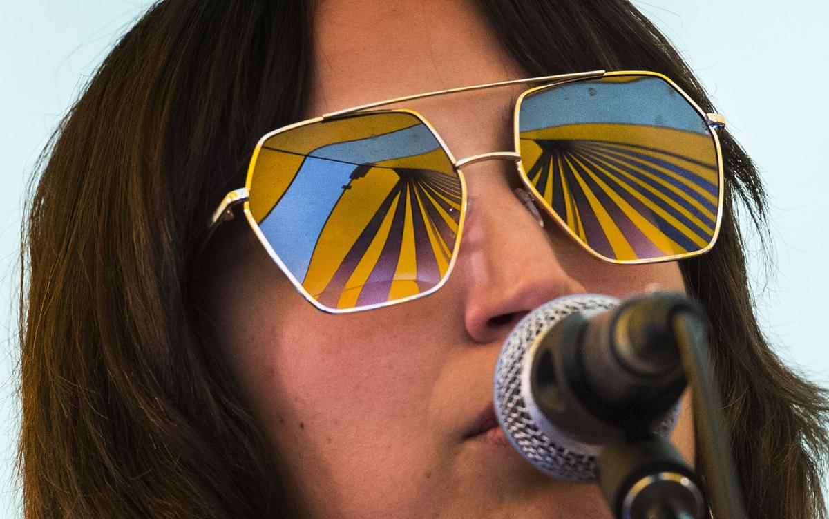 The iconic Meadowgrass tent is reflected in the sunglasses of In/PLANES bass player Desirae Garcia, as the Pueblo band performs Sunday, May 28, 2017, during the final day of the Meadowgrass Music Festival at La Foret Conference and Retreat Center in Black Forest. (The Gazette, Christian Murdock)