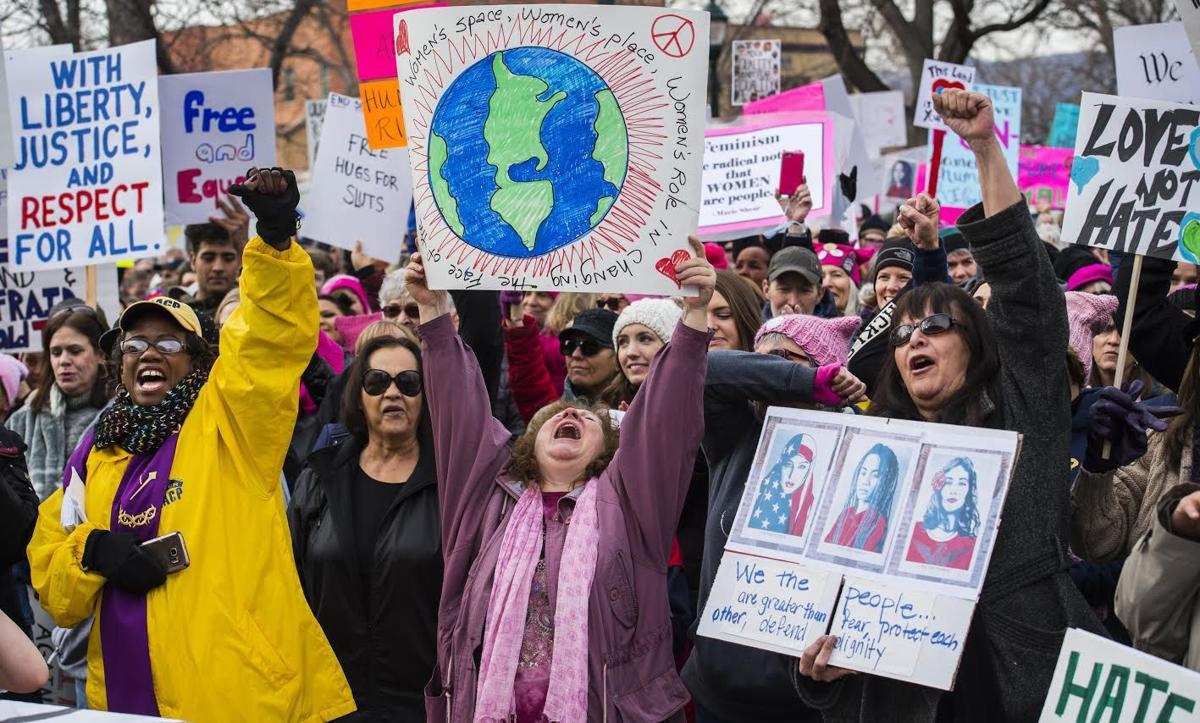 Rev. Tammy Garrett-Williams, left, Sharon River Hansen, and Sandra Walking Eagle cheer during a ralley in Acacia Park Saturday, Jan. 21, 2017, before the Colorado Springs Women's March in downtown Colorado Springs. The sister march of the Women's March on Washington, D.C., drew between 5,000 and 10,000 people. (The Gazette, Christian Murdock)