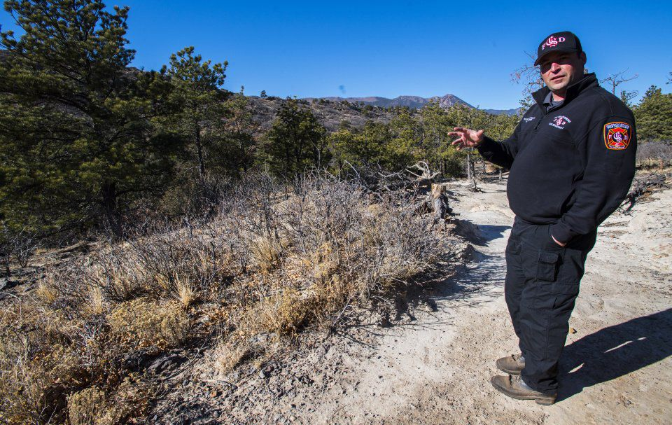 Aaron Davidson, the program coordinator for the Colorado Springs Fire Department Wildfire Mitigation team, explains the mitigation work needed in Ute Valley Park Friday, Dec. 22, 2017. A recent $1 million grant from the U.S. Department of Homeland Security's Federal Emergency Managament Agency to the Colorado Springs Fire Department will help the city's fire mitigation in the northwest city park as well as an open space adjacent to the Broadmoor Bluffs neighborhood. (The Gazette, Christian Murdock)