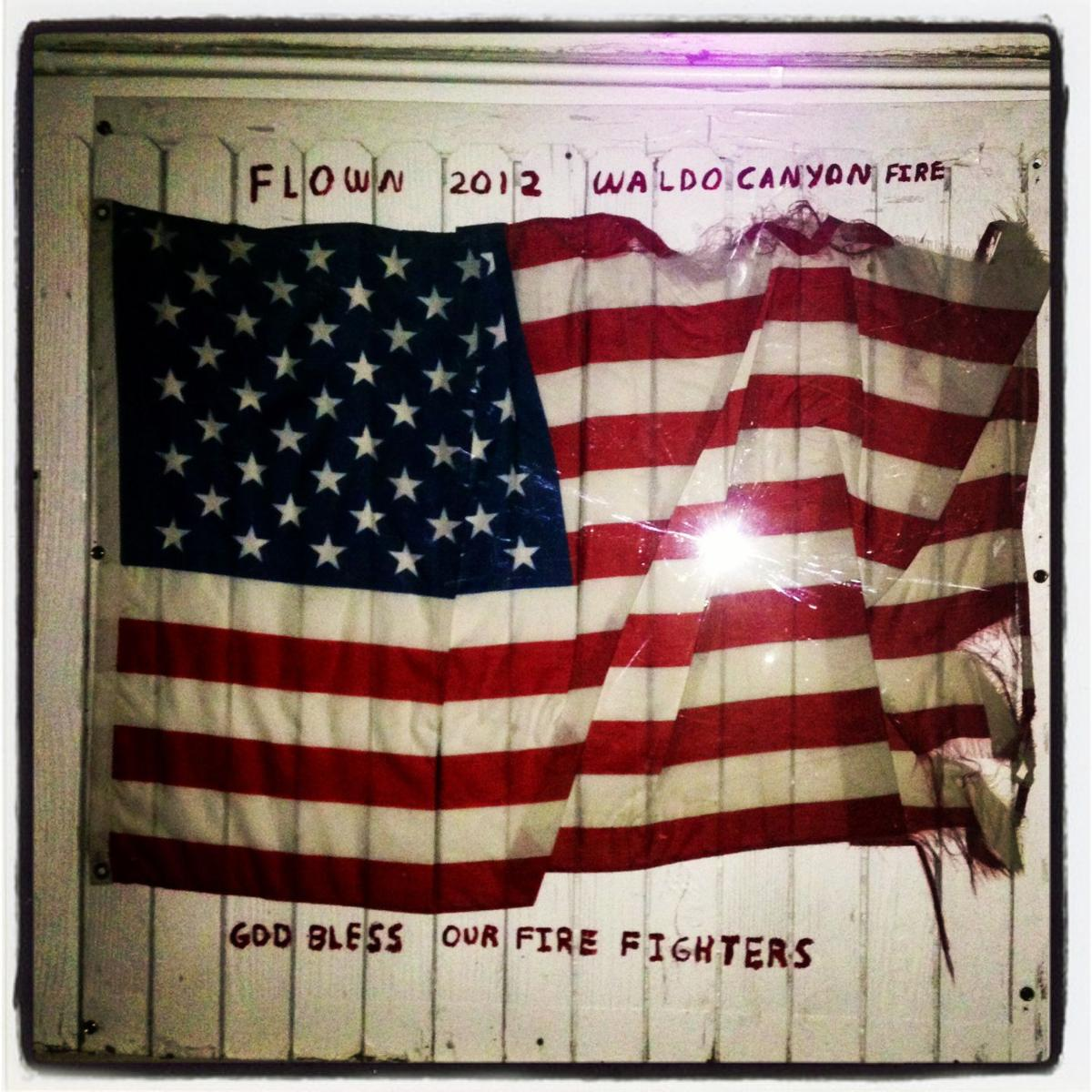 Flag that survived Waldo fire finds home on wall at The Drive In