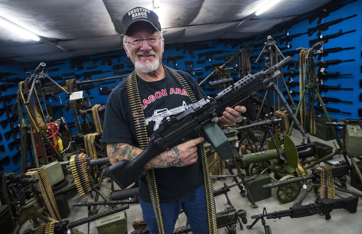 Mel Bernstein, AKA Dragon Man, poses with a modern machine gun among machine guns from World War I and newer Tuesday, Jan. 17, 2017, at Dragon Land east of Colorado Springs. (The Gazette, Christian Murdock)