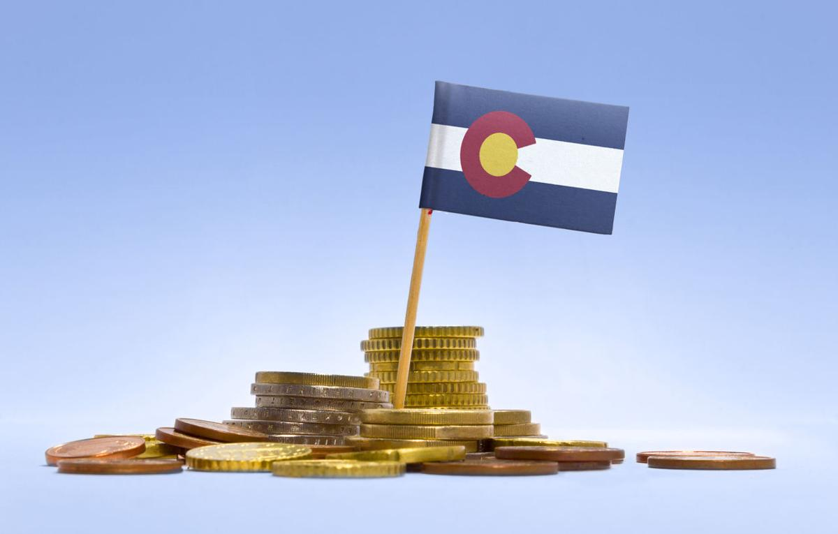 Flag of Colorado in a stack of coins.(series)