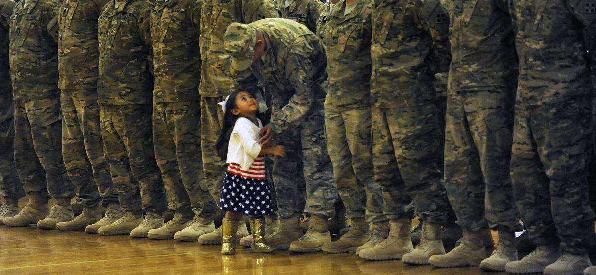 Karas Ogelsby had such a hard time waiting for the dismissal of the troops during a homecoming at Ft. Carson, She broke away from her mom and ran to her father, Lt. Daniel Ogelsby. Lt. Ogelsby gave her hug and gently sent her back to her mom until the end of the ceremony. Approximately 55 Ft. Carson soldiers from the 3rd Armored Brigade Combat Team, 4th I.D., returned from Southwest Asia on Tuesday, October 6, 2015. The troops have been gone since February. (Jerilee Bennett/The Gazette)