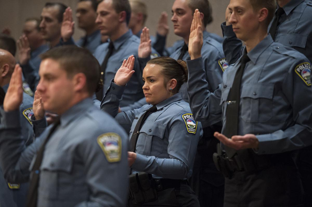 The 36 police officers from the 66th police class at the Colorado Springs Police Department Training Academy take their oaths of office Friday, April 14, 2017, during the graduation ceremony at the Village Seven Presbyterian Church.  (The Gazette, Christian Murdock)