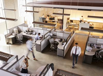 Elevated view of staff working in a busy open plan office