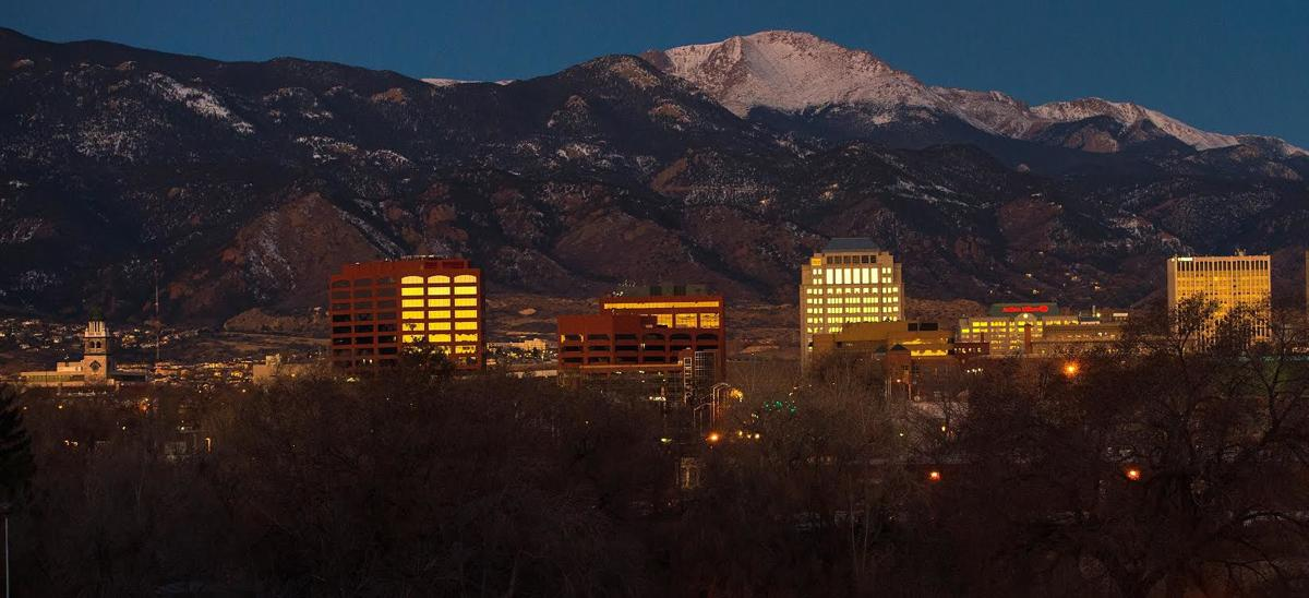 The sun rises over downtown Colorado Springs Friday, Feb. 13, 2015. Bankers, ecomomists, small business owners, and community acitvists are hopeful that the April city election will begin a new day in Colorado Springs politics. (The Gazette, Christian Murdock)