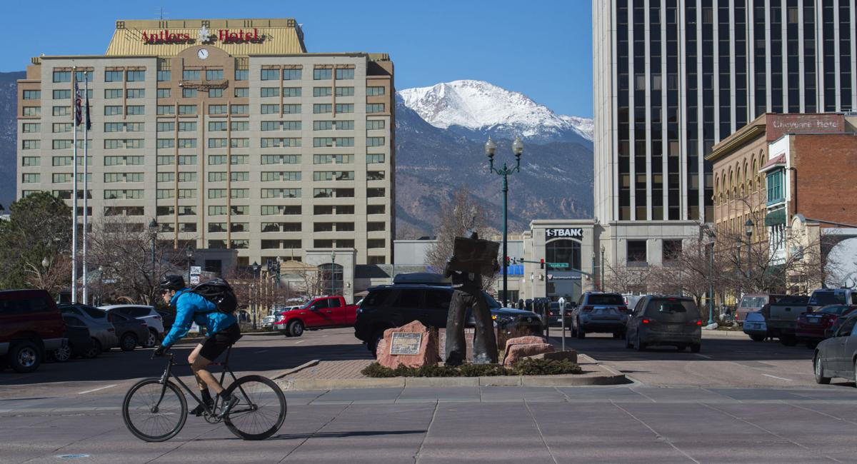 A cyclist rides along Tejon Street through downtown Colorado Springs Wednesday, Feb. 15, 2017. The city's downtown development plan includes better bike routes through downtown to connect regional trails and parks. (The Gazette, Christian Murdock)