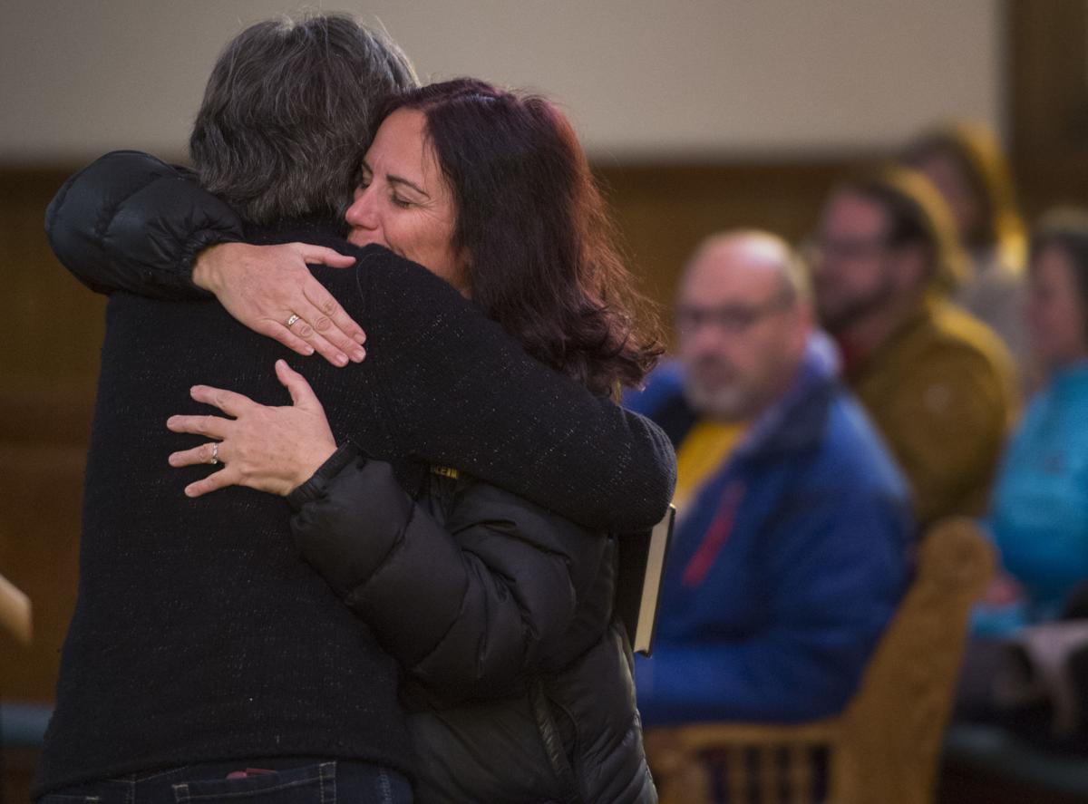 Deedle Murray, right, hugs another mourner Saturday, Nov. 28, 2015, before a vigil at the All Souls Unitarian Universalist Church in downtown Colorado Springs for the three killed in the shooting at the Planned Parenthood clinic Friday, Nov. 27, 2015. (The Gazette, Christian Murdock)