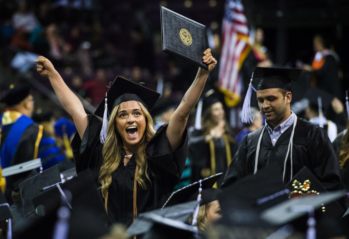 Sadie Urrestta celebrates after receiving her diploma during the  University of Colorado at Colorado Springs' morning commencement ceremonies Friday, May 12, 2017, at the Broadmoor World Arena in Colorado Springs. A record 1,532 students received their degrees this Spring.  (The Gazette, Christian Murdock)