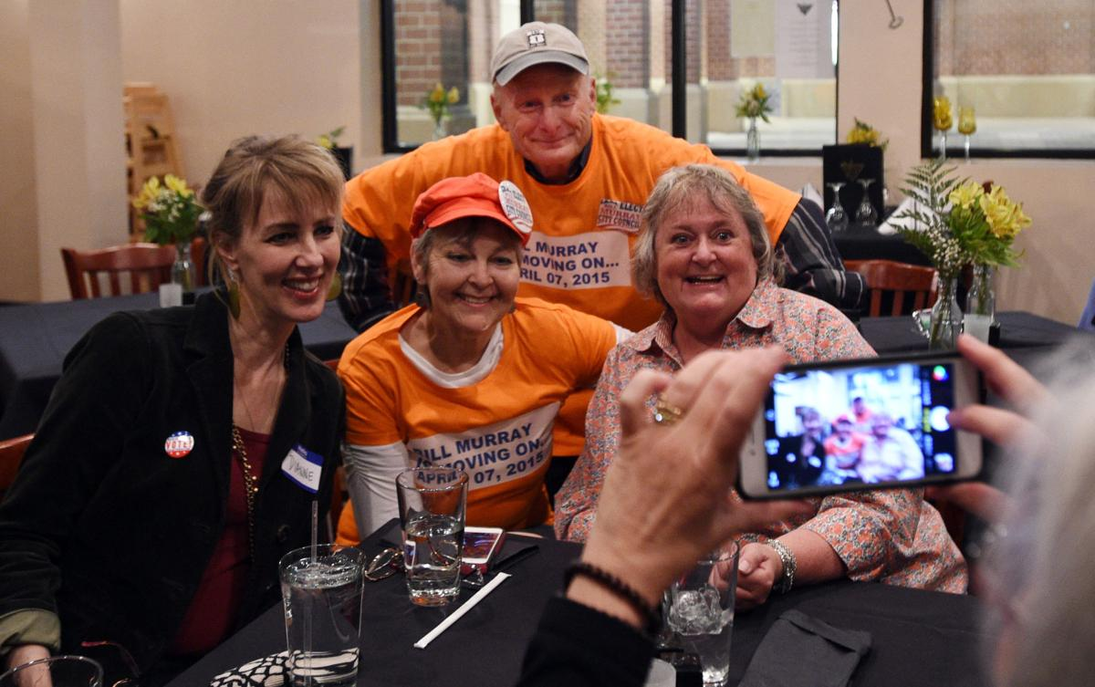 City Council candidate Bill Murray poses with his wife, Susan Murray (center front) and Dianne Perea (left) and Edwina Foreman (right) during a watch party at the Wobbly Olive on Tuesday, April 7, 2015. (JERILEE BENNETT/THE GAZETTE)