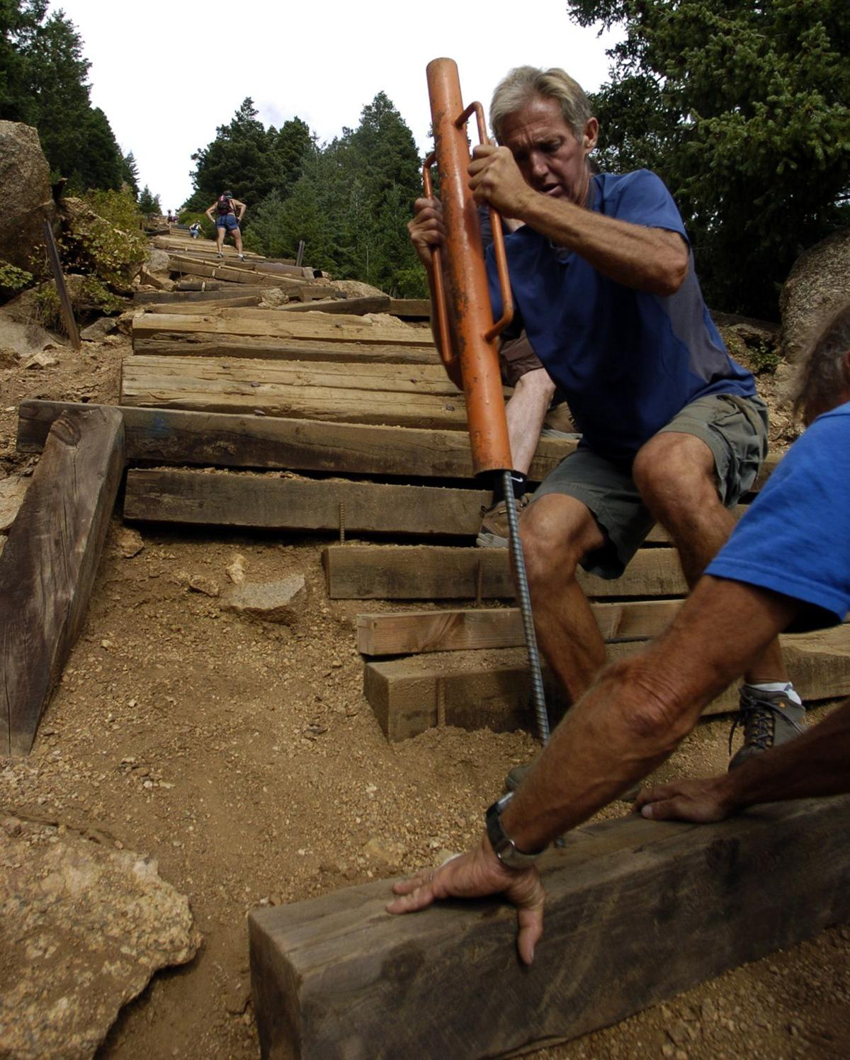 Ed Baxter, standing, and his brother Fred Baxter install new steps on Incline trail above Manitou Springs, Colo., Saturday, Sept. 10, 2005. Photo by Christian Murdock/The Gazette