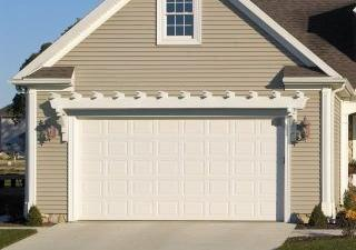 HOUSE TO HOME: Rethink your garage door to create a worthy focal point (copy)