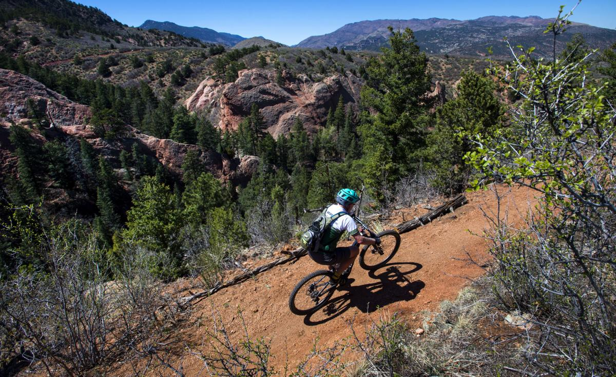 Beautiful Colorado Springs. A mountain biker rides the new Red Rock Canyon Overlook Loop or the Santa COS/719 Special trail Thursday, May 4, 2017, in Red Rock Canyon Open Space.  (The Gazette, Christian Murdock)