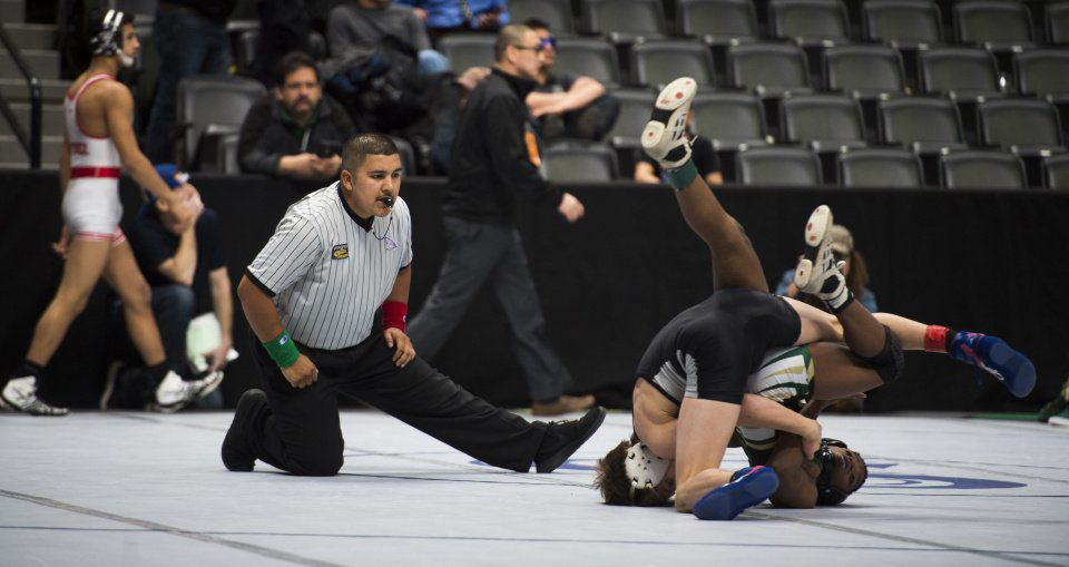 Kenneth Crosby from Falcon and Jett Strickenberger from Discovery Canyon High School grapple for third place at the end of the 106-4A consolation bracket at the State Wrestling Championship at the Pepsi Center in Denver, Colorado on February 17, 2018. (Nadav Soroker, The Gazette)