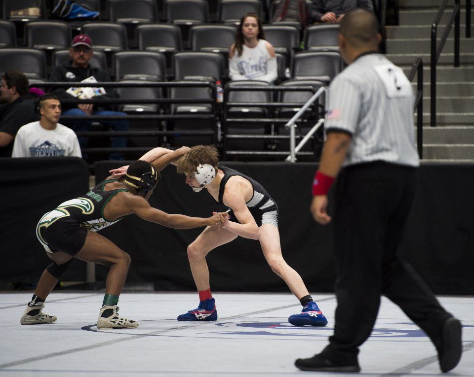 Kenneth Crosby from Falcon and Jett Strickenberger from Discovery Canyon High School face off for third place at the end of the 106-4A consolation bracket at the State Wrestling Championship at the Pepsi Center in Denver, Colorado on February 17, 2018. (Nadav Soroker, The Gazette)