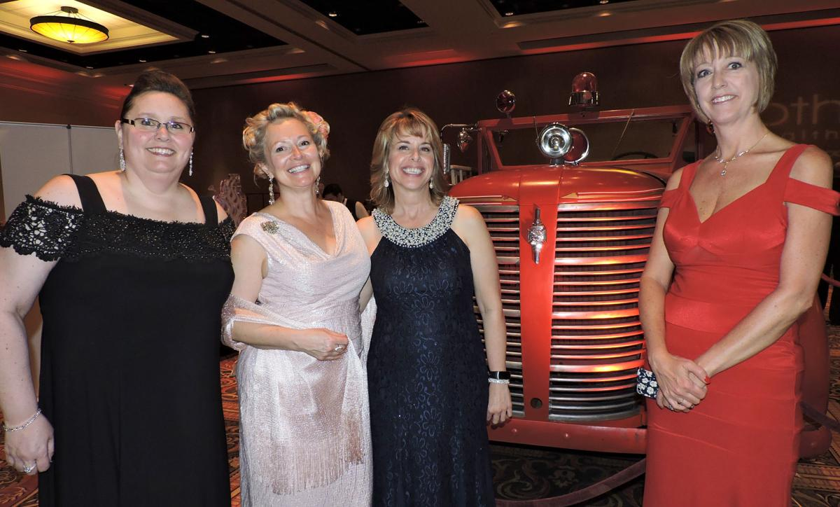 UCHealth Memorial Hospital Gala: from left, Cortney Lupo, Vicky Lee, April Smith and Sharon Branham pose with an antique fire engine. 042818 Photo by Linda Navarro