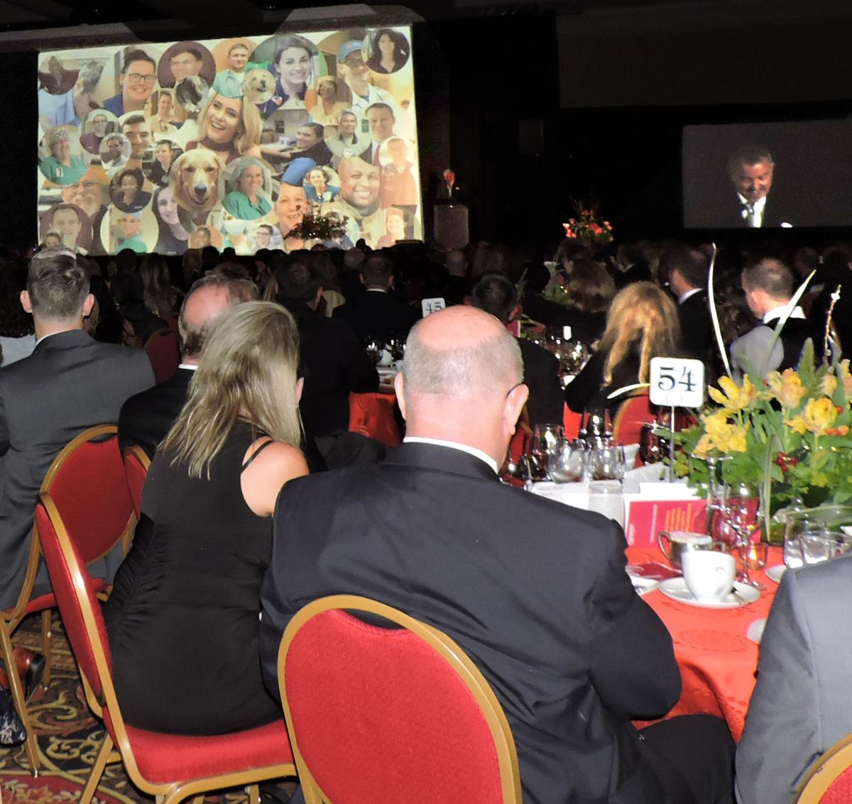 UCHealth Memorial Hospital Gala: In the center of the screen, a photo of trauma survivor London Lyle, surrounded by photos of the hundreds of healthcare folks who were part of her care 042818 Photo by Linda Navarro