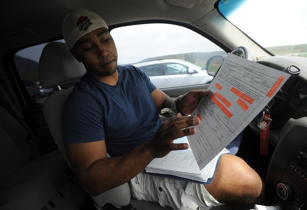 Former Air Force Cadet Eric Thomas shows some of the documents from his file Tuesday, May 28, 2013, the day before the Class of 2013 graduates at the Air Force Academy. Thomas, who was a confidential imformant and critical to several convictions, was kicked out of the academy in March, months short of graduating. (The Gazette, Christian Murdock)