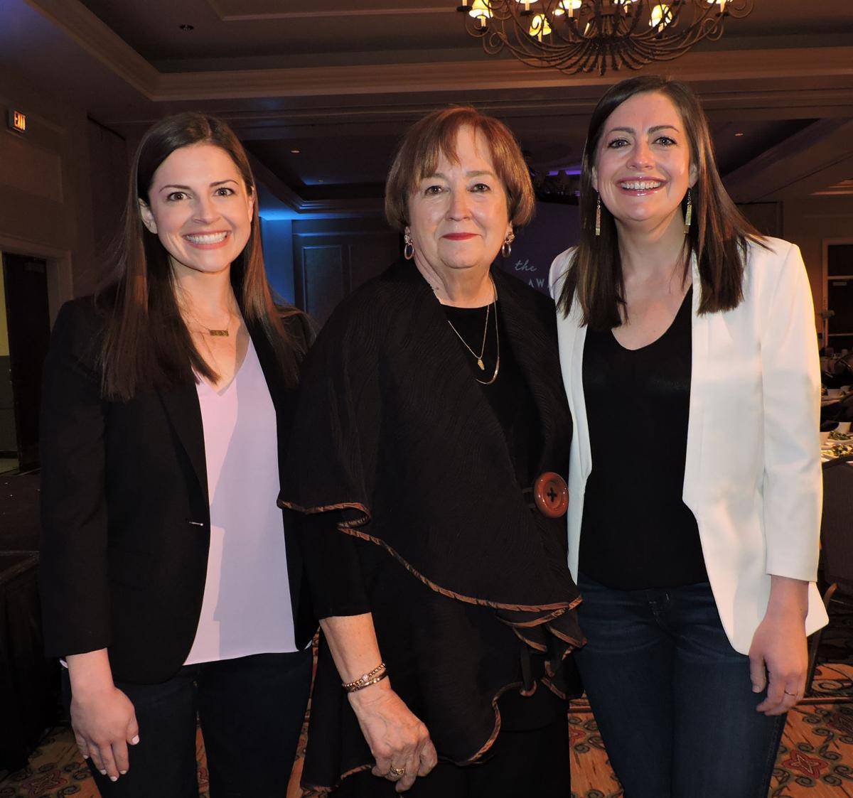 Athena Award luncheon: 2003 honoree Pam Shockley-Zalabak, center, with luncheon speakers Emily Nuñez Cavness, left, and Betsy Nuñez, who founded Sword & Plough, a veteran-owned company that repurposes military surplus into fashion bags and accessories. 040518 Photo by Linda Navarro