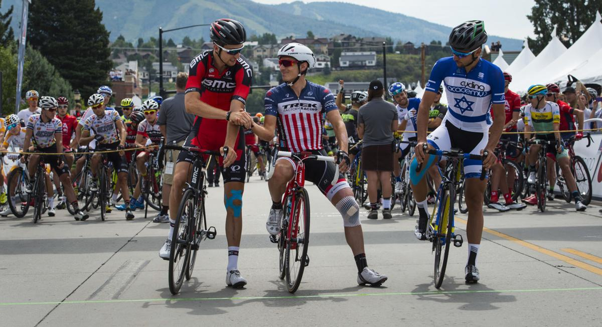 BMC's Taylor Phinney, left, shakes hands with Treck Factory Racing's Matthew Busche Monday morning, Aug. 17, 2015, before the start of Stage 1 of the 2015 USA Pro Challenge in Steamboat Springs, Colo. Stage 1 is a two-lap, 97 miles circuit beginning and ending in Steamboat Springs. (The Gazette, Christian Murdock)
