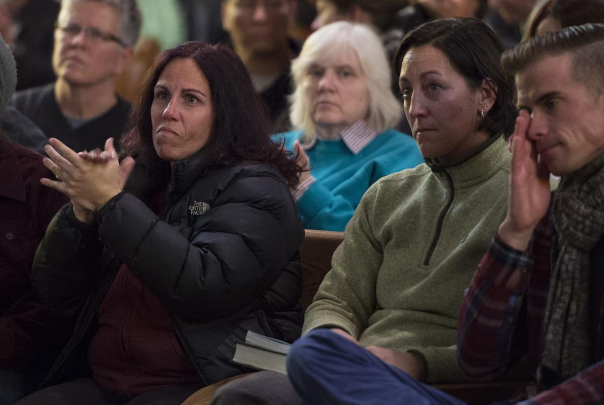 Deedle Murray applauds one of the speakers Saturday, Nov. 28, 2015, during a vigil at the All Souls Unitarian Universalist Church in downtown Colorado Springs for the three killed in the shooting at the Planned Parenthood clinic Friday, Nov. 27, 2015. (The Gazette, Christian Murdock)