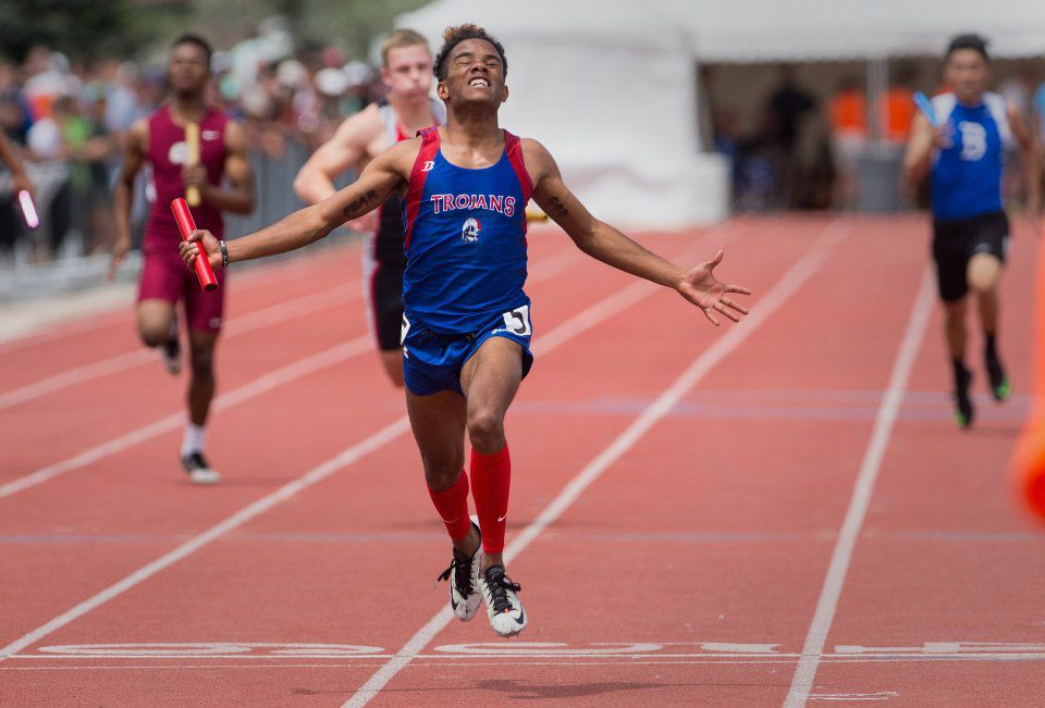 Fountain-Fort Carson's Christian Lyon crosses the finishline as the Tojan 4x200 relay team wins the 5A title Friday, May 20, 2016, during the second day of the Colorado State Track and Field meet at Jefferson County Stadium in Lakewood, Colo. (The Gazette, Christian Murdock)
