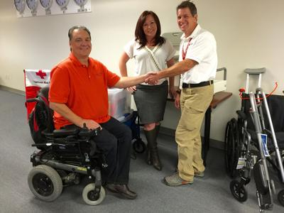 The Independence Center presents disability access kits to local Red Cross chapter