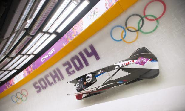 Bobsledders representing their country on two accounts
