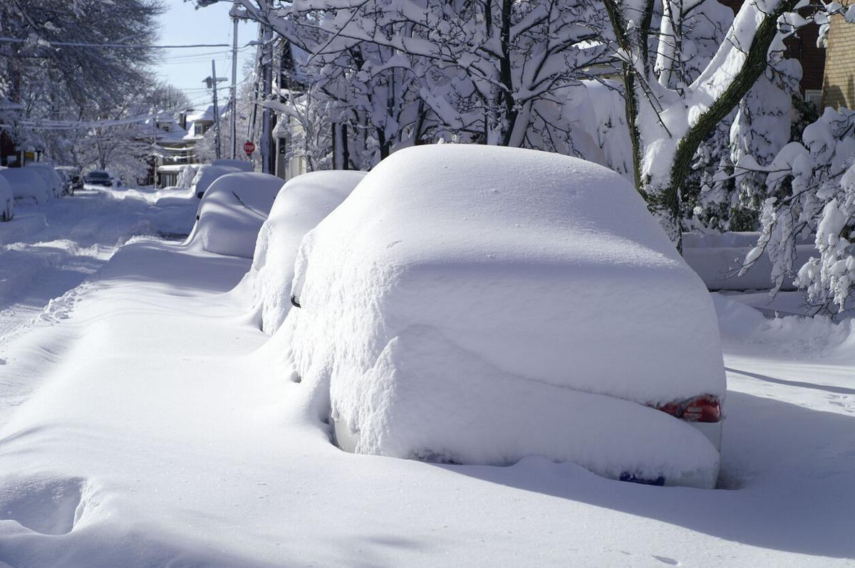 Parked Cars Covered with Snow in Blizzard on City Street Photo Credit: bgwalker (iStock).