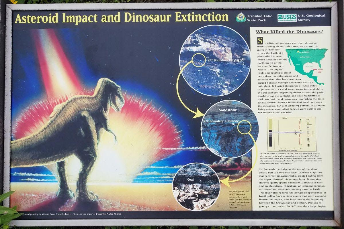 interpretive sign in Trinidad Lake State Park explains the scientific theory of the extinction of dinosaurs