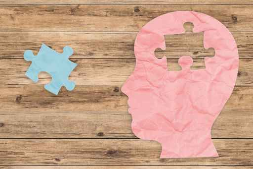 mental health concept with side face and jigsaw pieces
