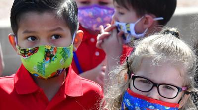 Elementary school kids wearing masks