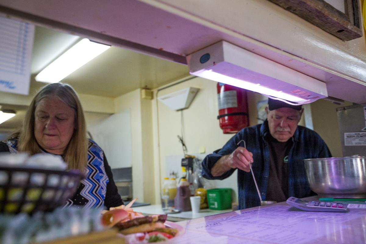 Sherie and Willis Kelly serve up dinner for themselves at their final all-you-can-eat dinner at the Rush Cafe before they close in Rush, Colorado Wednesday, February 21, 2018. The Kelly's grabbed a table to eat at and were quickly joined by friends.(Nadav Soroker, The Gazette)
