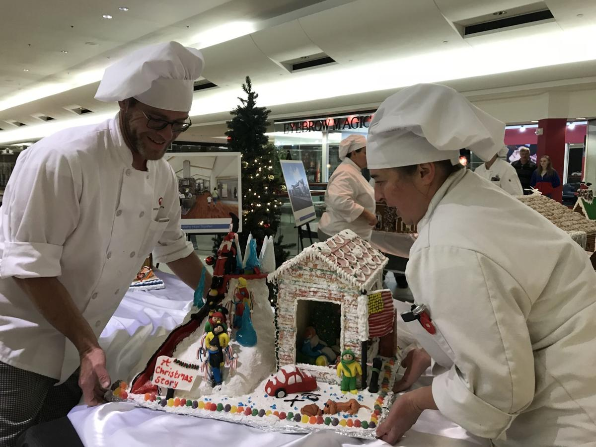 Culinary arts students with gingerbread houses