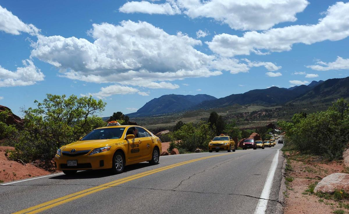 """A line of Yellow Cabs drive into Garden of the Gods Friday, April 27, 2012, to remember fellow cab driver Norm LePage, 63, who died last week. LePage was cab driver for about 20 years, a decorated Vietnam Veteran and friend to many. """"We just wanted one more day with Norm,"""" his son, Shale LePage said. (The Gazette, Christian Murdock)"""