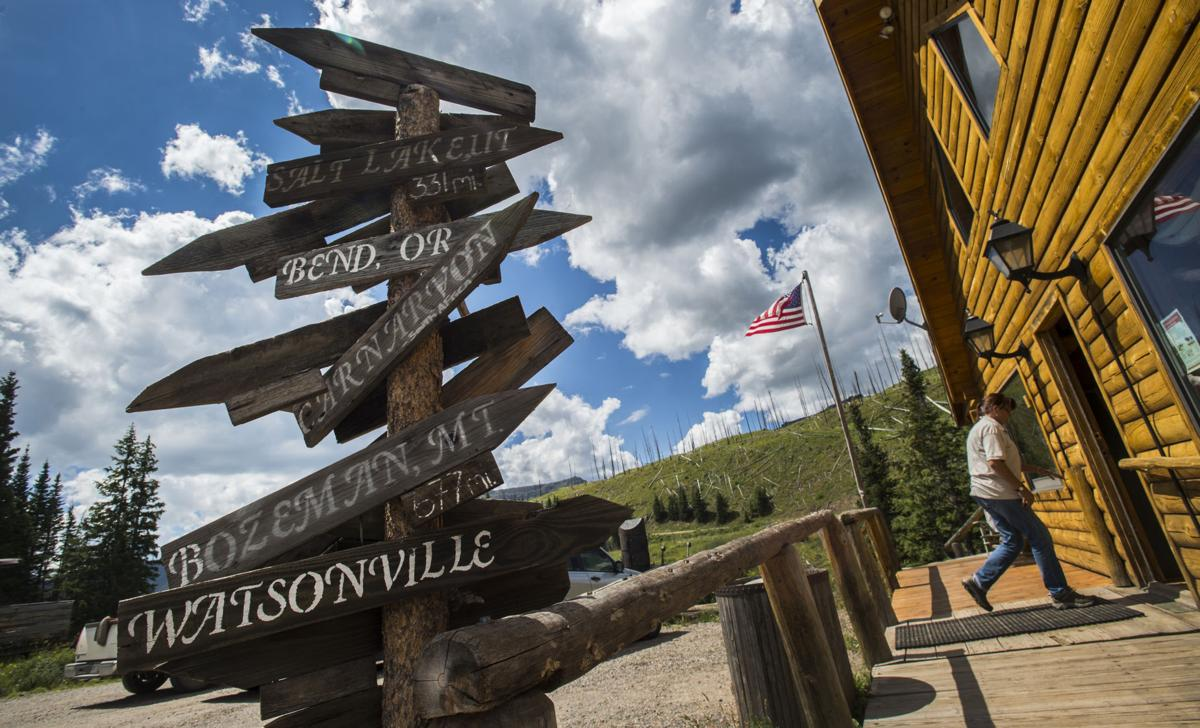Directional signs left at Trappers Lake Lodge from a wedding party from a couple years before decorates the outside of Trappers Lake Lodge, Tuesday, Aug. 9, 2016. (The Gazette, Christian Murdock)