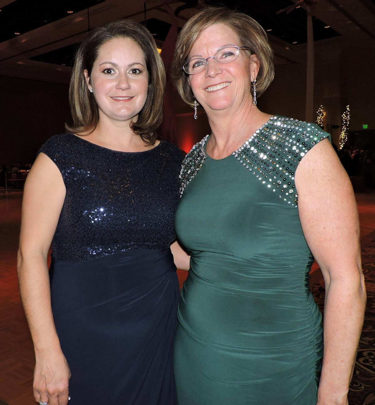 Margo, left, and Debbie Chandler, chair of the Heart Ball. 021917 Photo by Linda Navarro