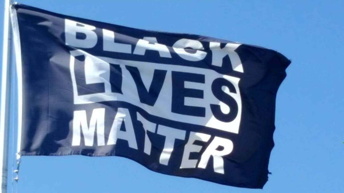 'Black Lives Matter' flag honors De'Von Bailey outside Colorado Springs church | David Ramsey