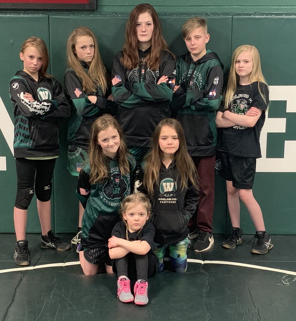 Female members of the Woodland Park Wrestling Club team