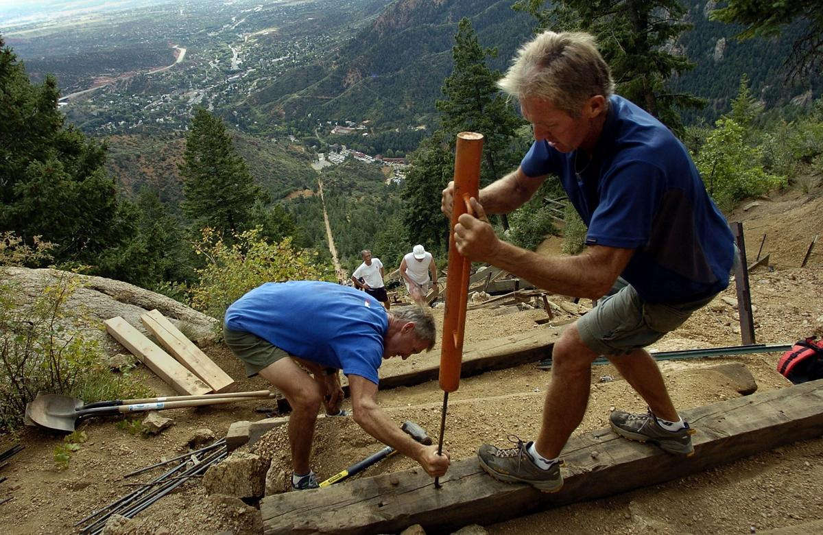 Fred Baxter, left, and his brother, Ed Baxter, install new steps along the steep Incline Trail above Manitou Springs, Colo., Saturday, Sept. 10, 2005. The trail to the top of Mount Manitou has an average grade of 41 percent with some parts reaching 68 percent grade. That and Pikes Peak violent weather makes trail maintenance a year-long battle. Photo by Christian Murdock/The Gazette