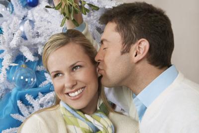 Why do we kiss under the mistletoe during the holidays?