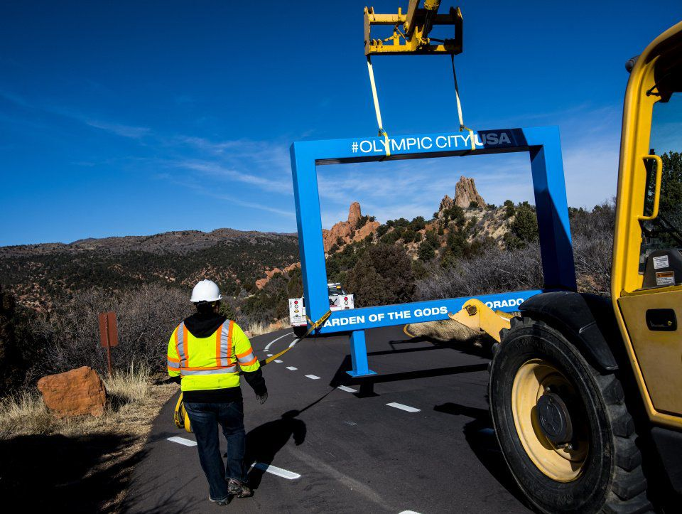 Rock formations in the Central Garden Area of Garden of the Gods Park are framed by the controversial 12-foot blue frame as a crew from the Colorado Springs Park and Recreation department tranports it through the park Monday, Dec. 18, 2017 after it was removed from the High Point Overlook. The blue frame was installed Thursday as a marketing idea by the Olympic City USA task force and the locals quickly rejected it. As of Monday morning, more than 20,000 people had signed a petition started Friday. (The Gazette, Christian Murdock)