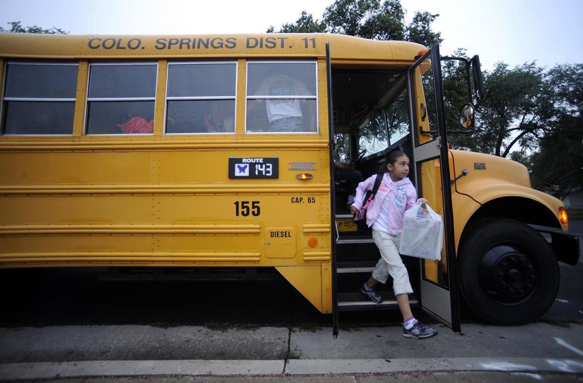 Student exits D11 school bus