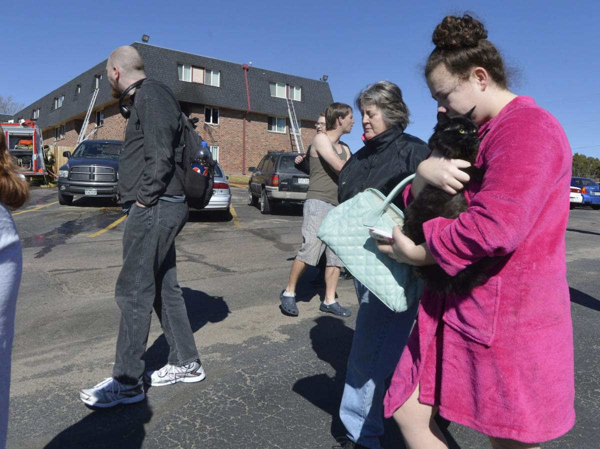 Many residents of the Devonshire Square Apartments near Circle dr. and W. Uintah St. were displaced by a fire on Wednesday morning, March 19, 2014. (The Gazette/Jerilee Bennett)